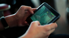 EDITORIAL Close-up of boy playing game on his tablet HD Stock Footage