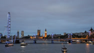 Stock Video Footage of London Eye Big Ben Parliament Thames River Ship Boat Ferry Passing Night Lights