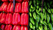 Red sweet peppers paprika found next to green Stock Footage