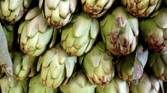 Ecological big artichokes piled Stock Footage