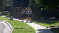 Three Teenage Girls Talking, Walking & Texting In School Uniforms Stock Footage