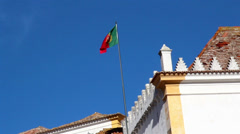 Waving portugal flag on a blue sky Stock Footage