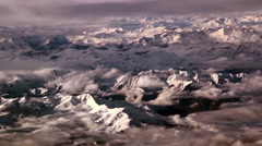 Clouds above rocky mountains thin clouds and the white mountain Stock Footage