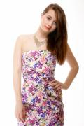 Stock Photo of cute young woman in summer dress on white