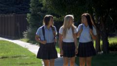 Three Teenage Girls Talking & Walking In School Uniforms Stock Footage