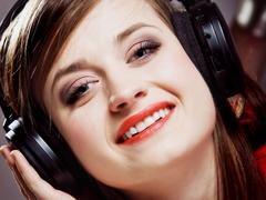Stock Photo of close up smiling girl with headphones