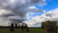 Stock Video Footage of Tractor rake on a background of clouds. Time Lapse