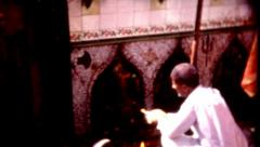 8mm old film middle eastern man performing a religious practice Stock Footage