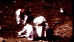 8mm old film middle eastern men gutting a lamb in a river  Stock Footage