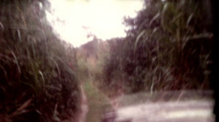 Old film POV Riding in a Jeep on a tour at Tiger Tops Lodge jungle vintage Stock Footage