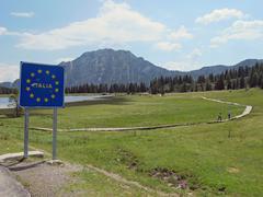 Sign with yellow stars on the italian border Stock Photos