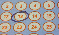 Tab of the lottery with a circled number Stock Photos