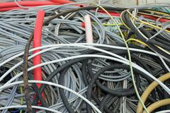 Tangle of insulated copper wire in a landfill Stock Photos