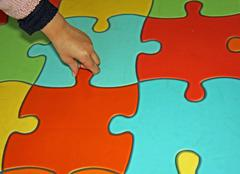 puzzle pieces of a complicated game - stock photo