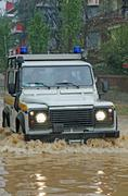 rescue car in a way flooded during a flood - stock photo