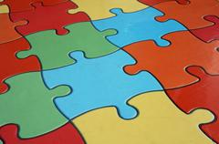 Puzzle pieces of a complicated game Stock Photos