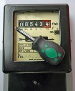 screwdriver and figures of an electricity meter - stock photo
