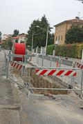 Stock Photo of roadworks with a excavation for the laying of high voltage power cable