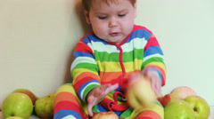 Child with apples Stock Footage