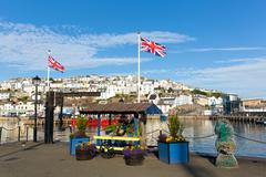 Union jack flags at harbourside Brixham harbour Devon with blue sky Stock Photos