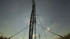 High Voltage Transmission Towers Silhouette - stock footage