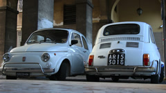 Two old classic Fiat 500 cars in street of Rome 3 Stock Footage
