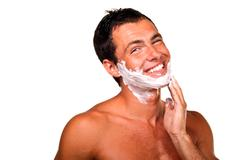 sexy handsome young man with a shaving foam, smiling - stock photo