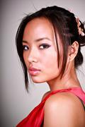 closeup portrait of a young beautiful asian woman - stock photo