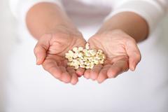handful of pills - stock photo