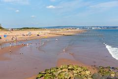 Dawlish Warren Devon England with holidaymakers enjoying a summer day - stock photo