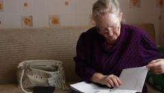 elderly woman versed in documents - stock footage