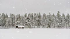 Traditional log cabin in a winter stow storm Stock Footage