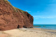Red rock beach Dawlish Warren Devon England Stock Photos