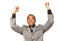 Young african-american businessman celebrates his victory isolated on white b Stock Photos