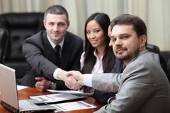 multi ethnic business team at a meeting. interacting. focus on caucasian man  - stock photo