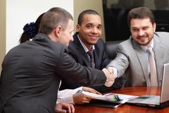 multi ethnic business team at a meeting. interacting. focus on african-americ - stock photo