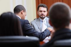 Mature businessman interviewing new people Stock Photos