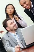 multi ethnic business team at a meeting. interacting. - stock photo