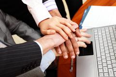 Image of business people hands on top of each other. Stock Photos