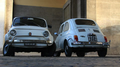Two old classic Fiat 500 cars in street of Rome 4 Stock Footage