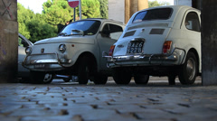 Two old classic Fiat 500 cars in street of Rome 5 Stock Footage