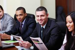 multi ethnic business team at a meeting. focus on caucasian man - stock photo