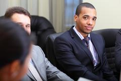 Multi ethnic business team at a meeting. focus on african-american young man Stock Photos