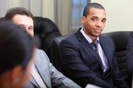 Stock Photo of multi ethnic business team at a meeting. focus on african-american young man