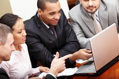 multi ethnic business team at a meeting - stock photo