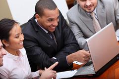 multi ethnic business team at a meeting. focus on african-american man - stock photo