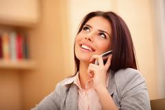 Beautiful business woman talking on cell phone and looking at copyspace Stock Photos