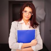Young beautiful businesswoman in office holding a folder Stock Photos