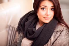 closeup portrait of a cute young woman at home - stock photo