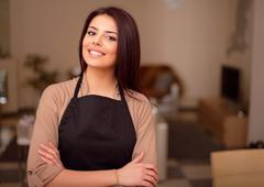 beautiful young smiling housewife is proud of her appartment - stock photo